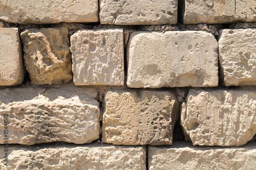 Photo  Maltese stone wall, cut-stone globerigina limestone