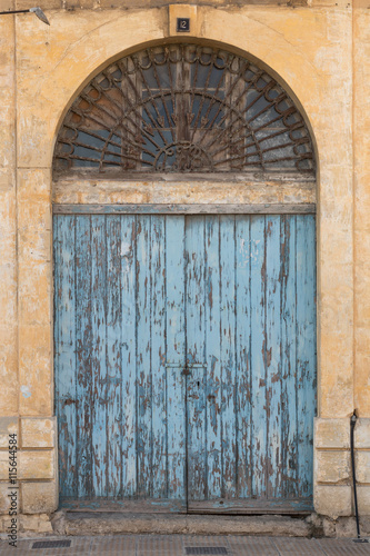 Photo  Old ornate wooden doorway painted blue