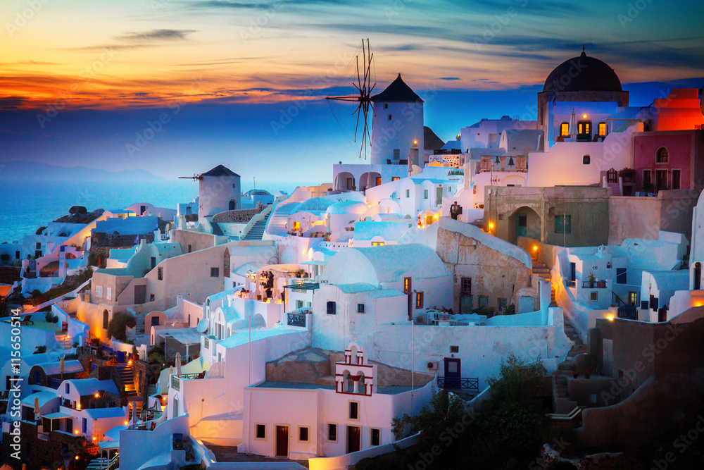 Fototapety, obrazy: lights of Oia village at night, Santorini Greece, toned