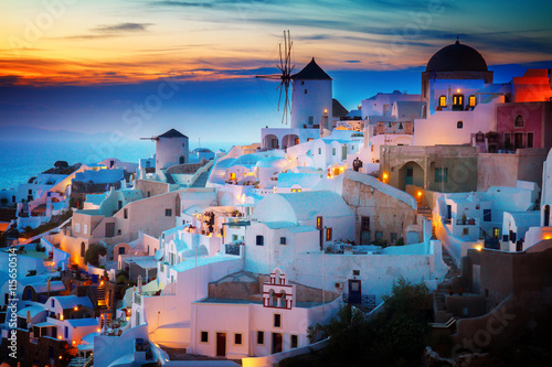 Poster de jardin Santorini lights of Oia village at night, Santorini Greece, toned