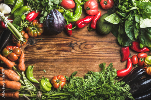 Staande foto Groenten Fresh raw vegetable ingredients for healthy cooking or salad making over rustic wood background, top view, copy space, horizotal composition