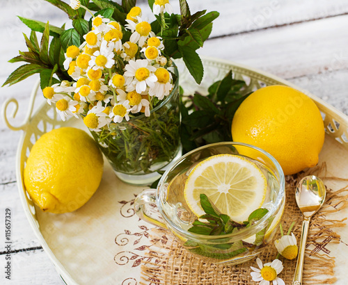 Chamomile tea with lemon and mint. Herbal tea. Dietary menu. Proper nutrition.