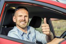 Man At The Wheel Of His New Car