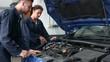 Mechanics repairing an engine in the garage