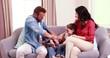 Happy family tickling on sofa
