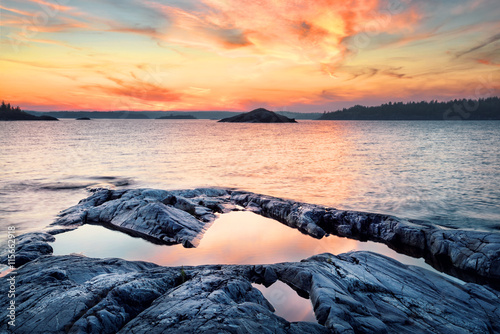 Fotografia, Obraz  Stone shore of the lake at sunset
