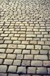 Vintage toned cobblestones at sunrise, street in Poznan, Poland.