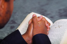 Man Folding Hands Praying With...