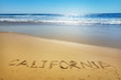 California written on the sand of a beach, vacation concept background