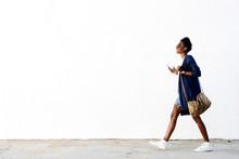 Trendy Black Woman Listening Music On Mobile Phone