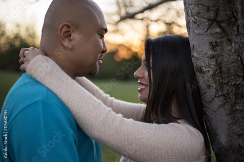 Fotografie, Obraz  Young latino couple on a romantic date at a park during sunset