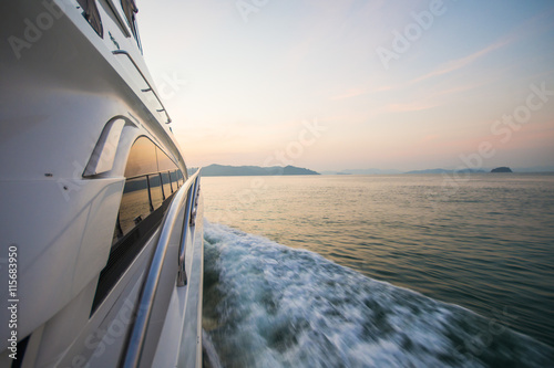 luxury boat yacht on the sea at sunset time