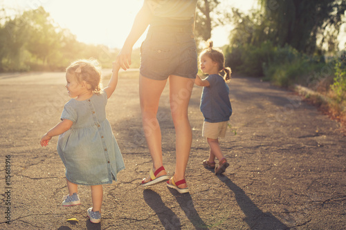Single Mother walk with two children