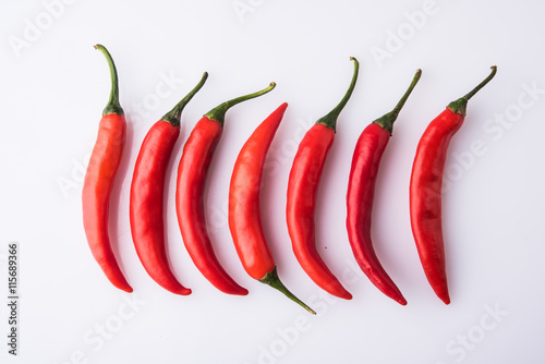 dipicting uniqueness concept using green and red chillies. showing different or special or originality concept or against the stream concept using fresh red and green chillies