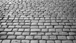 Black and white photo of cobblestone pavement
