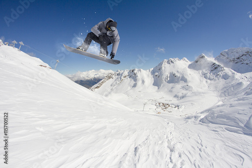 plakat Snowboard rider jumping on mountains. Extreme snowboard freeride sport.