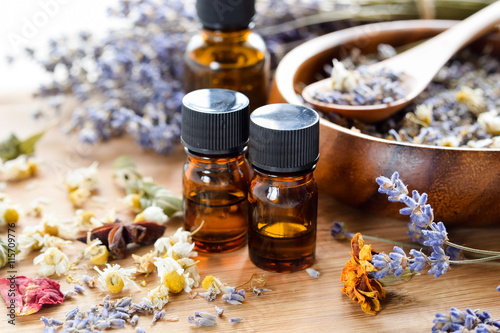 Fotografie, Obraz  essential oils with dried herbs