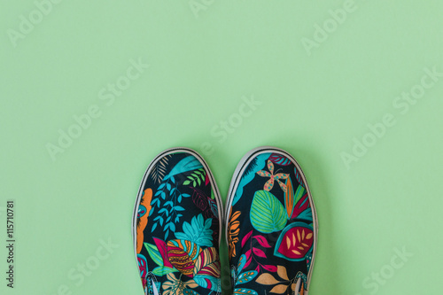 Fotografie, Obraz  Flat lay fashion set: colored slippers shoes with palm and flowers print on pastel background