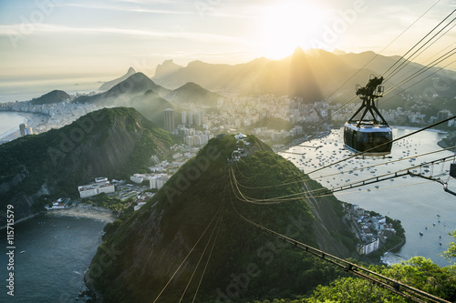 Poster Rio de Janeiro Bright misty view of the city skyline of Rio de Janeiro, Brazil with a Sugarloaf (Pao de Acucar) Mountain cable car passing in the foreground