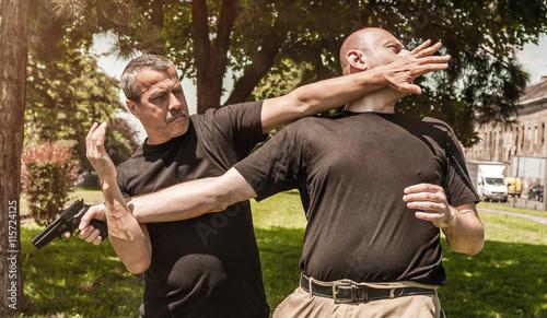 Photo  Kapap instructor demonstrates self defense techniques against a gun