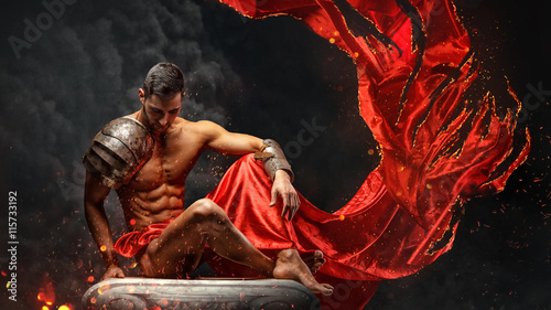 Poster Tissu Artistic portrait of muscular male in red waving fabric.