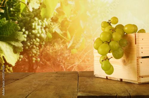 Fotobehang Wijngaard summer grapes on wooden table