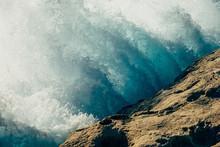 Wave Crashing Against Rock