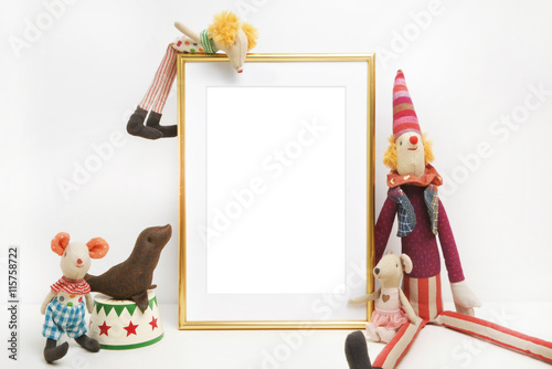 Gold frame mock-up, and white wall with toys.mouse, circus. Place ...