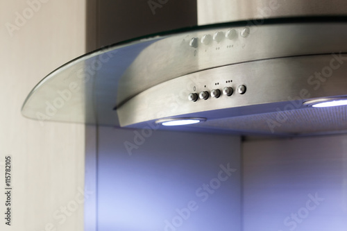 Closeup of Convenient operation kitchen hood with toggle modes Plakát