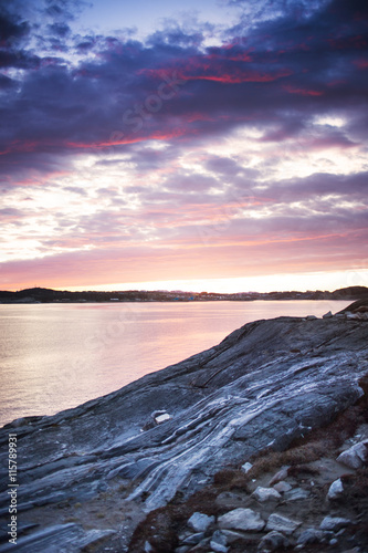 Scenic view of sea and rocks during sunset