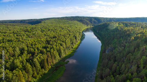 Poster de jardin Vue aerienne endless forest, bend calm river in clear day aerial view