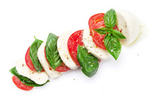 Caprese Salad. Mozzarella, Tomatoes And Basil