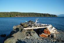 Driftwood Shelter On A Rocky Beach