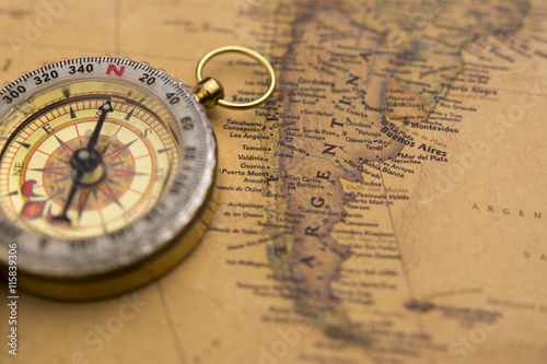 Old compass on vintage map selective focus on Argentina #115839306