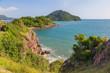 Mountain coast in deep blue sea with blue sky
