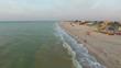 Flying over the sea shore at sunrise. coastal zone