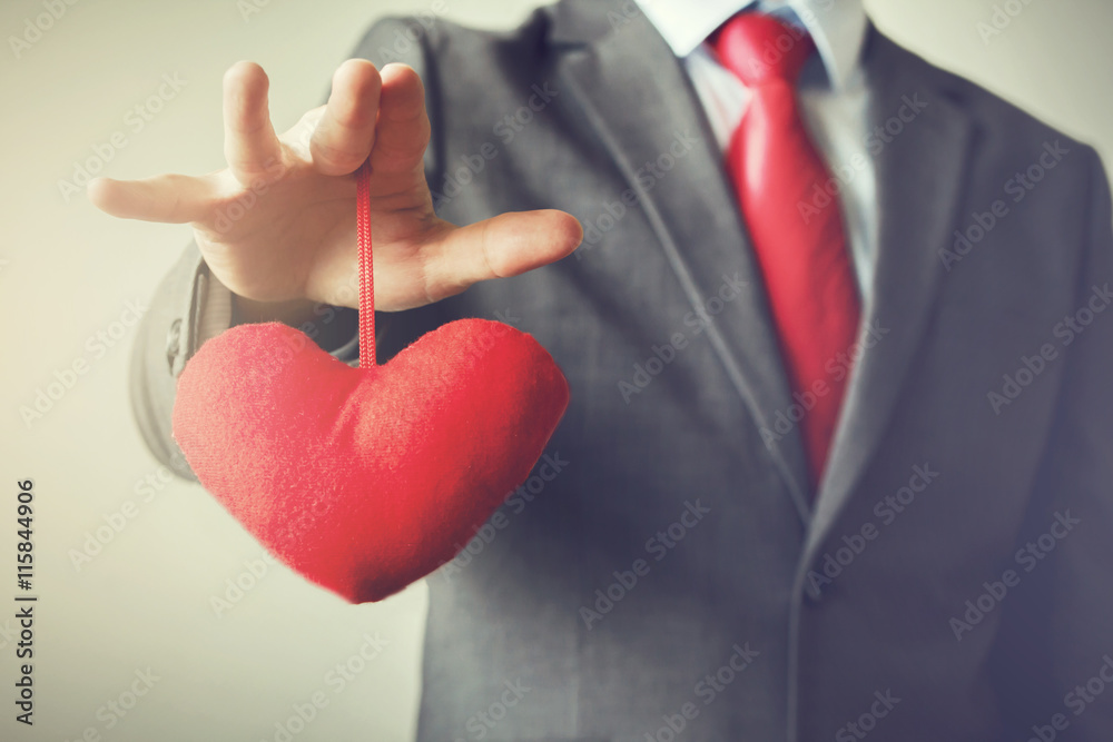 Fototapeta Businessman winning and controling customer's heart concept in Vintage tone