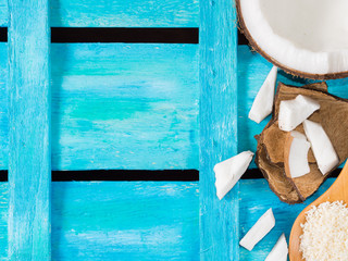 Coconut on bright blue wooden background