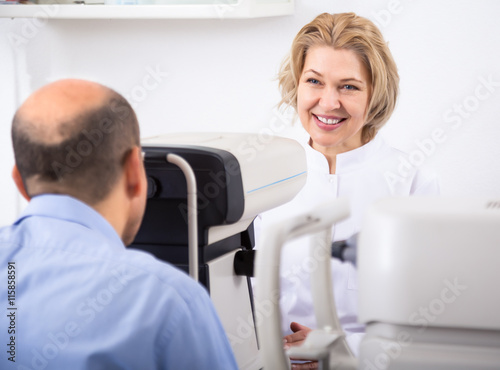 Fototapety, obrazy: Ophthalmologist and male pensioner checking eyesight