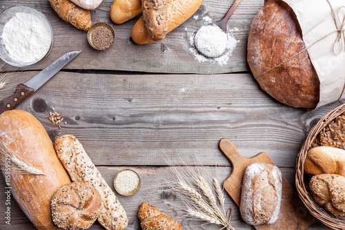 Printed kitchen splashbacks Bread Delicious fresh bread on wooden background