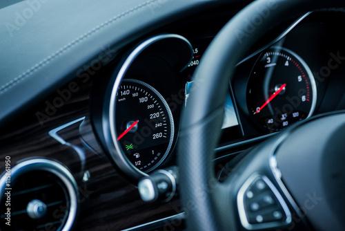 Photo  Luxury car interior details. Speedometer, steering wheell