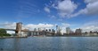 A wide angle view of the New York Skyline and the Brooklyn Bridge as seen from Brooklyn.