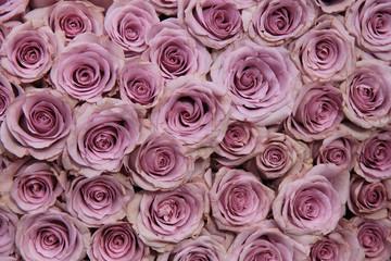 Purple rose wedding arrangement