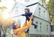 Leinwandbild Motiv father with son playing and having fun outdoors