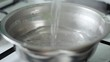 Pouring boiled water into a steel pan