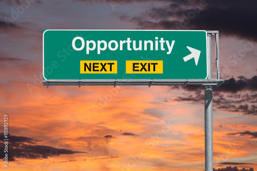 Fotografía  Opportunity Next Exit Freeway Sign with Sunrise Sky
