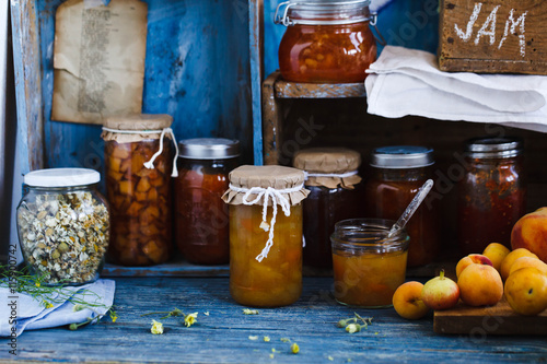 Photo  Preserve fruts jam and jelly jars