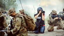 Photojournalist Documenting War Conflict. In The Mountain.