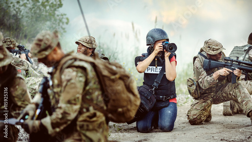 Fotografie, Obraz  Photojournalist documenting war conflict. in the mountain.