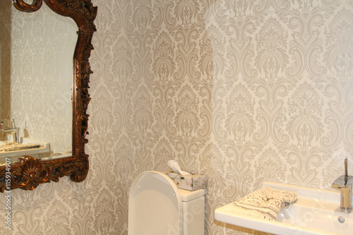 Elegant Bathroom With Pale Damask Wallpaper And Ornate Baroque